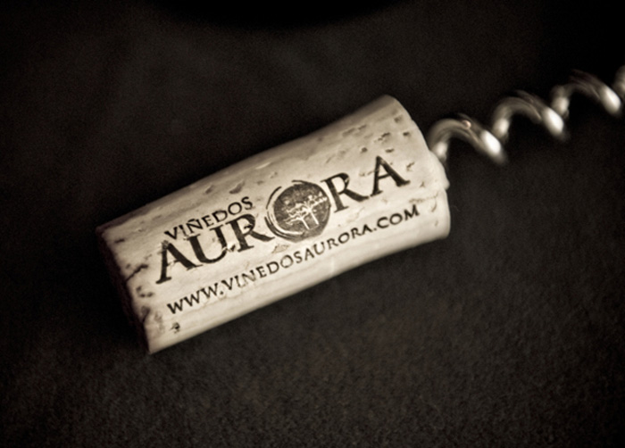 Viñedos Aurora logo on wine bottle cork. Logo designed by Julie Mendez.